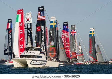 SAN FRANCISCO, CA - OCTOBER 4: The America'??s Cup World Series fleet crosses the starting line in a fleet race in San Francisco, CA on October 4, 2012