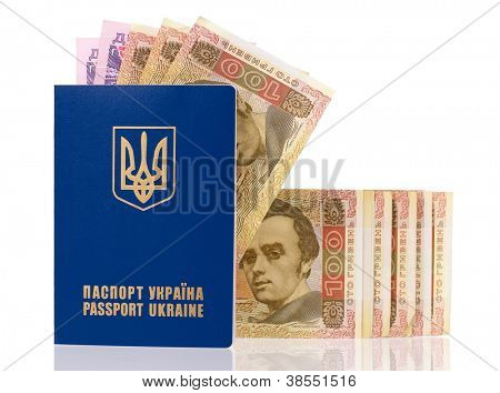 International Ukrainian passport with Hryvna banknotes isolated on background