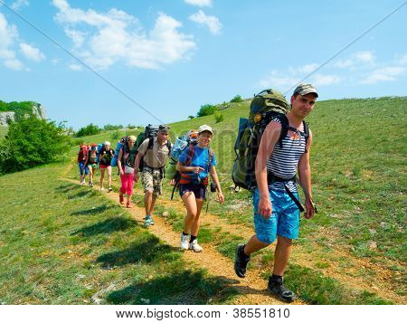 CRIMEA, UKRAINE - MAY 05: Unidentified hikers walk on a path on May 05, 2012 in Crimea Mountains, Ukraine. This place is very popular for outdoor activities for hikers from Russia and Ukraine