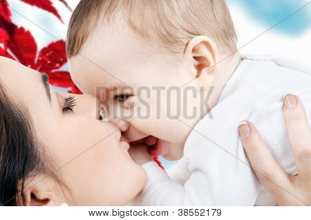picture of happy mother with baby in autumn leaves