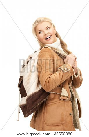 picture of woman in sheepskin jacket with backpack