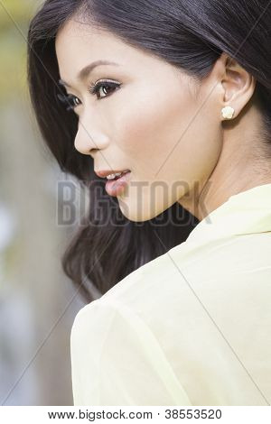 Outdoor portrait of a beautiful sophisticated young Chinese Asian Oriental woman