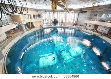 STAR TOWN - FEBRUARY 4: Underwater simulators in round pool in Cosmonaut Training Center on February 4, 2012 in Star town near Moscow, Russia. Center was established on January 11, 1960.