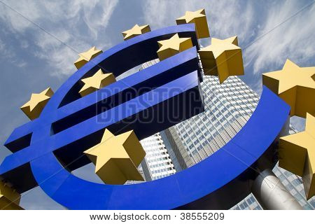 FRANKFURT, GERMANY - AUG 23: The Famous Big Euro Sign at the European Central Bank on August 23, 2012 in Frankfurt, Germany. The bank was established by the Treaty of Amsterdam in 1998.