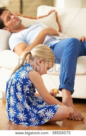 Daughter Painting Sleeping Father's Toenails At Home
