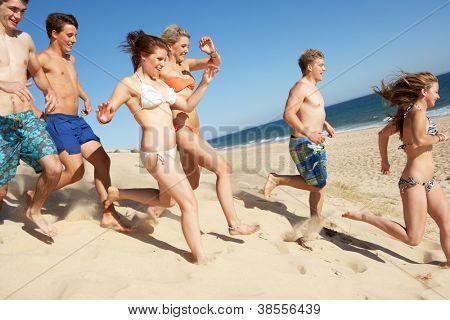Group Of Teenage Friends Enjoying Beach Together
