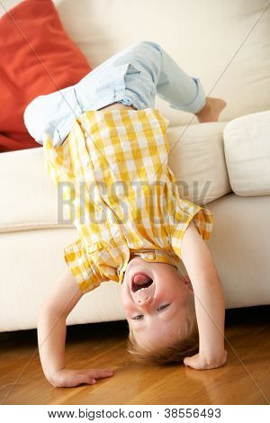 Young Boy Relaxing On Sofa At Home
