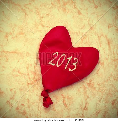 the number 2013, as the new year, written on a heart-shaped balloon on a marbled background