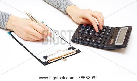 Business concept with pen and calculator