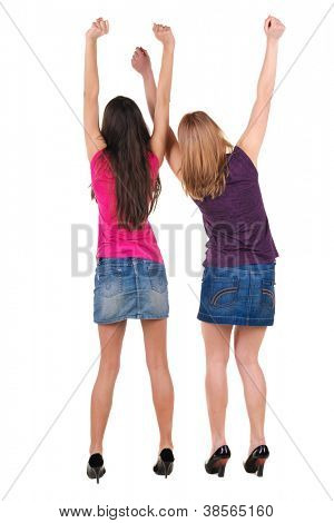 Back view of two rejoice young woman . Rear view people collection.  backside view of person.  Isolated over white background.