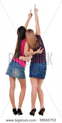 Back view of two pointing young women. Rear view people collection.  backside view of person.  Isolated over white background.