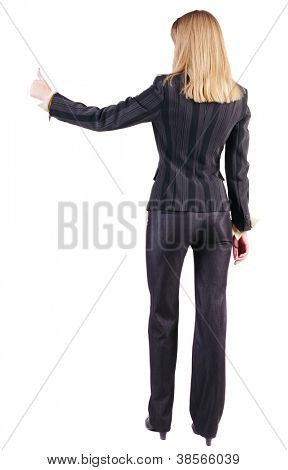 back view of standing young blonde business woman showing thumb up. businesswoman gesturing ok sign. Rear view people collection.  backside view of person.  Isolated over white background