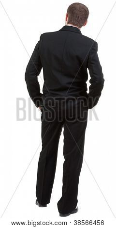 back view of Business man  looks ahead. Young guy in black suit watching.Rear view people collection.  backside view of person.  Isolated over white background