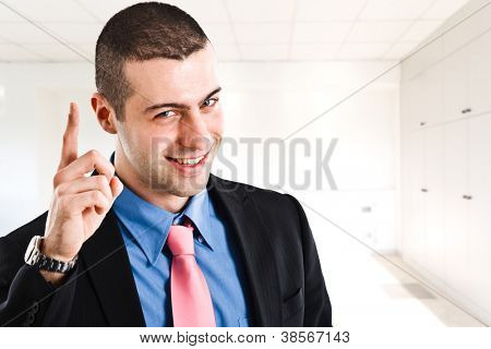 Man pointing his finger up