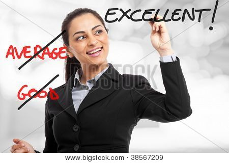 Woman erasing average and good and writing excellent