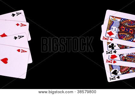 Four aces versus four kings - on the black background