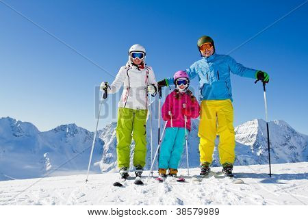 Skiing, winter - happy family ski team