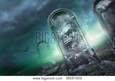 Halloween Season, faces on a gravestone.