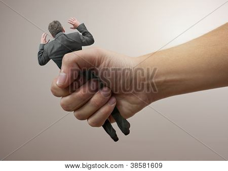 Squeezed  - A businessman being squeezed