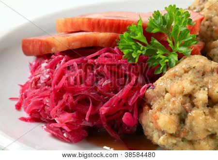 Dish of smoked pork with Tyrolean dumplings and red kraut