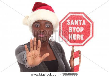 Girl holding a sign Santa Stop Here