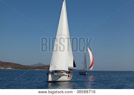 "SARONIC GULF, GREECE - SEPTEMBER 26: Competitors boats during of sailing regatta ""Viva Greece 2012"" on September 26, 2012 on Saronic Gulf, Greece."