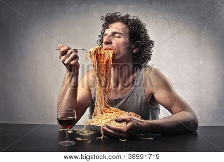 Man gorging of red spaghetti
