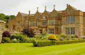 Manor House In The Medieval Castle In England In Summer Day poster