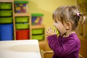 foto of starving  - Happy children and healthy food baby girl eating fruit at school - JPG