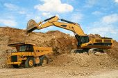 foto of dumper  - Backhoe loader loading dumper truck excavation heavy - JPG