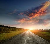 stock photo of paved road  - paved country road with surprisingly beautiful sky - JPG