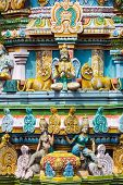 stock photo of trichy  - Sculptures on Hindu temple gopura  - JPG