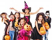 stock photo of carving  - Halloween party with group children holding carving pumpkin - JPG
