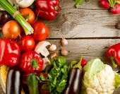 stock photo of wooden basket  - Healthy Organic Vegetables on a Wooden Background - JPG