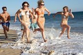 Group Of Teenage Friends Enjoying Beach Together