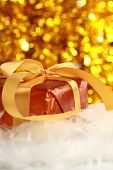 christmas golden gift on a furry background poster