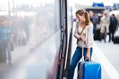 image of goodbye  - Pretty young woman at a train station - JPG