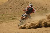 foto of motocross  - motocross bike in a race representing concept of speed and power in extreme man sport - JPG