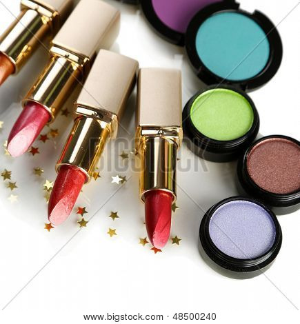 Beautiful lipsticks and eye shadows isolated on white