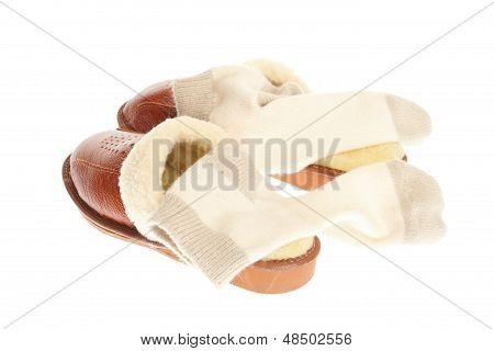 Brown Slippers And Sock Isolated On A White Background.