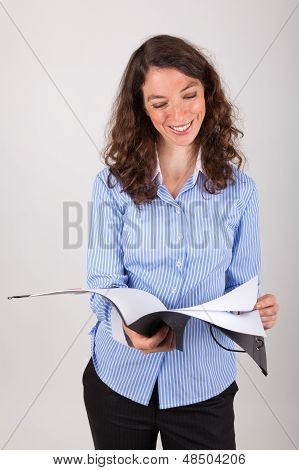 The Young Business Woman Is Reading In A Record