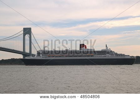 Queen Mary 2 cruise ship in New York Harbor under Verrazano Bridge leaving New York