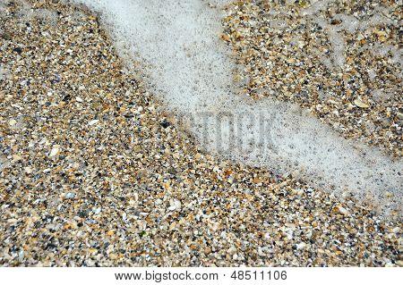 Surf mar sobre fondo de piedra Concha y guijarro