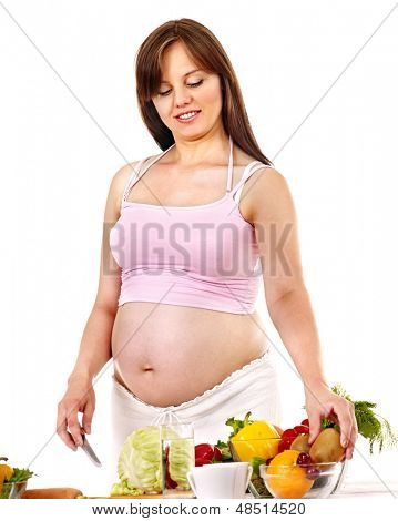 Pregnant woman preparing food in the kitchen Isolated.
