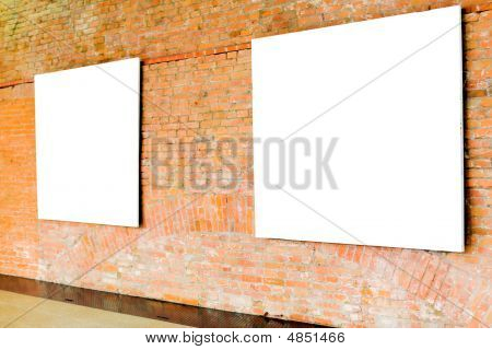 Two Frames On Brick Wall