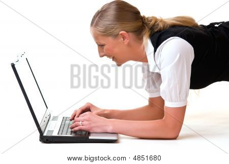 Blonde Young Woman Writing On A Laptop