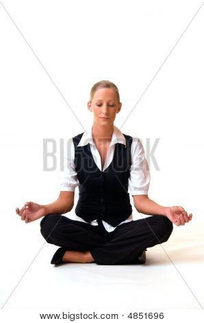 Young Woman Sitting In Meditation