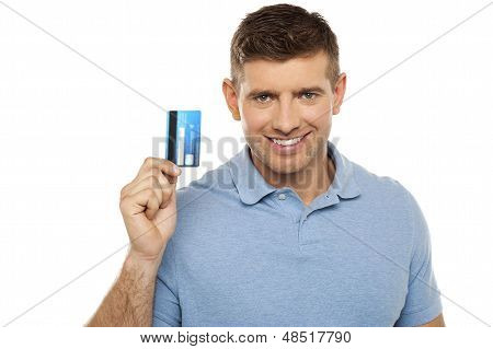 Cheerful Man Holding Credit Card