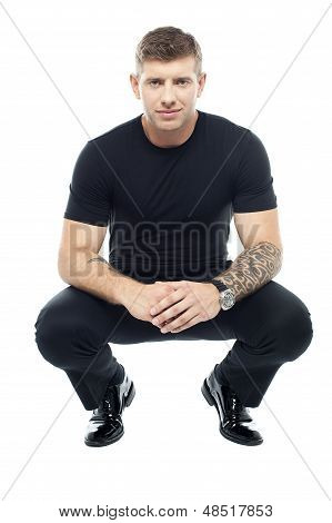 Handsome Male Bouncer Squatting Position