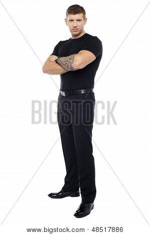 Bouncer With Tattoo On Hand Posing With Arms Crossed